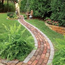 make a simple garden path from recycled pavers or cobblestones set on a sand bed learn all the details of path building from breaking cobblestones to easy