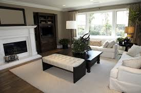 Black Wood Frame With White Tufted Leather Bench Ottoman, Seated Next To  Large Black Wood