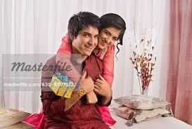 Teenage Girl Hugging Her Brother At Raksha Bandhan Stock Photo Inspiration Picture For Brother Sister