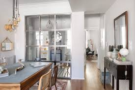 modern furniture style. Entrance Of A Bohemian Home With Steel Framed Glass Partition And Mismatched Mid-century Modern Furniture Style O
