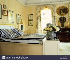 Striped Bedroom Curtains Yellow Striped Wallpaper And Floral Curtains In Townhouse Bedroom