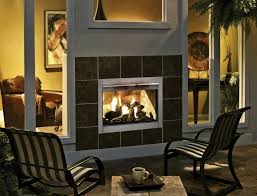 awesome outdoor isokern fireplace between the glass window plus chairs for terrace decor ideas