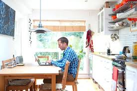 kitchen and bathroom remodeling man on computer researching kitchen remodeling plans kitchen and bathroom remodel companies