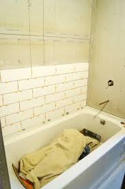 Beautiful subway tile bathroom remodel renovation Master Bathroom The Walls Surrounding The Tub Are Getting These Beautiful And Fresh Looking 12 White Subway Tiles Think It Is Going To Look So Clean And Bright Delawareonlineinfo Our Main Bathroom Remodel Week 5