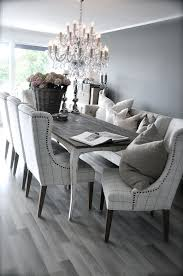 grey rustic dining table with beautiful fabric chairs the bination is modern and elegant