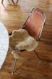 charlotte perriand dining chairs leather sling with swatches of fur