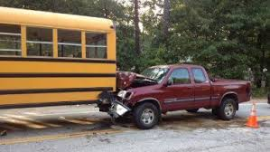 Charges possible after truck hits school bus