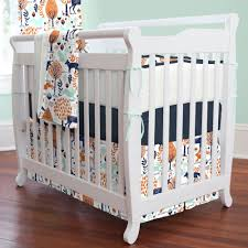 navy and orange woodland mini crib bedding