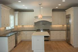 jet mist granite for a traditional kitchen with a asian statuary and kitchen by ideal tile