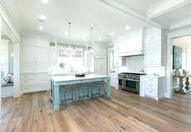 white cabinets with wood floors white cabinets with wood floors white cabinets with powder blue kitchen island and oak wood floors photos white kitchen