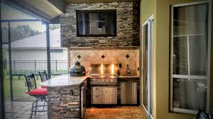 granite and stonework outdoor kitchen with entertainment