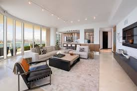 Bright living room lighting High Ceiling Here Are Some Great Track Lights In This Bright And Modern Living Room The Track Home Stratosphere 40 Bright Living Room Lighting Ideas