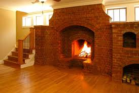 wide brick fireplace hooked on houses