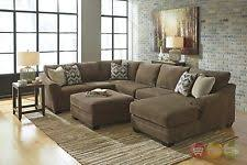 ashley furniture sectional couches. Justyna Teak Deluxe Brown U Shaped Sectional Sofa With Ottoman By Ashley 89102 Furniture Couches S