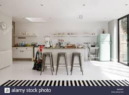 Tiled Kitchen Open Plan White Tiled Kitchen With Barstools And Retro Fridge