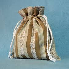 learn how to make a small reusable lined drawstring gift bag tutorial by