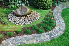 garden ground cover. Japanese Garden With Cobbled Path, Water Feature And Ground Cover