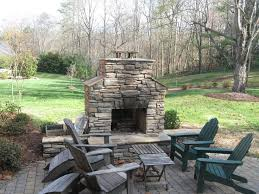 outdoor stone fireplace with paver patio