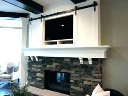 above fireplace where to put cable box mount tv no studs hanging over ca