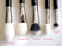 this is a big slightly pointed brush that can be used for a diffused contour effect and to set your makeup with loose powder the tapered end means that