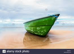 Boat With Cracked Green Color Paint On Sand Beach Of Baltic Sea Coastline  In Jurmala, Latvia.