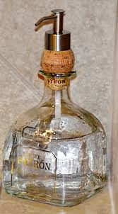 Put a dispenser through a cork into any type of bottle to make a soap  dispenser