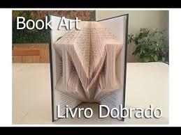folded book art using photo arte feito de paginas dobradas