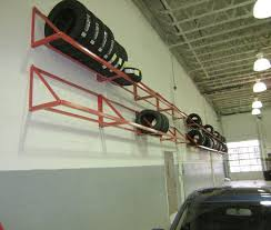 wall mount tire rack.  Mount MWM66  Wall Mount Tire Rack Shelving In A Shop With Tire Rack E