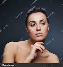 portrait woman natural makeup dark background stock photo