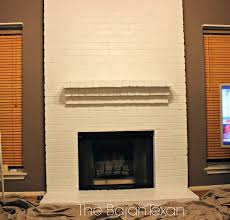 brown and white painting brick fireplace