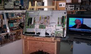 tv repair shop. guy tv repair work shop tv