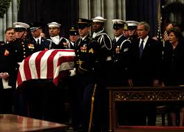 u s department of > photos > photo gallery the casket of former u s president gerald ford is carried past u s president george w