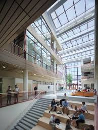 Interiors are arranged around a three-story atrium.