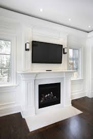 this wooden mantle with a marble hearth are a brilliant white color for a