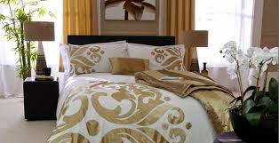 image of gold white and black bedding