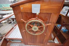 wooden classic motor yacht twin engine the helm duplicated in wheelhouse