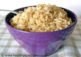 cooked brown rice in a bowl.  Cooked Bowl Of Healthy Cooked Brown Rice On Cooked Brown Rice In A Bowl E