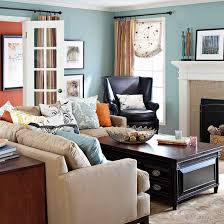 discreet storage packed into a couple core furniture pieces such as the coffee table and sofa table adds great functionality to this family room gathering bhg living rooms yellow
