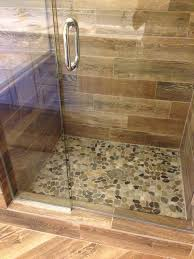 shower remodel natural look with mosaic flat rock pebbles and wood looking tile contemporary