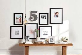 pick a variety of photos from family to fido to decorate your wall with