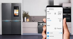 A refrigerator and the right hand holding Galaxy S8 with remote control  screen.