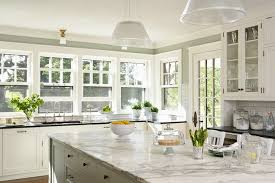 beautiful u shaped kitchen with wall of windows behind kitchen sink