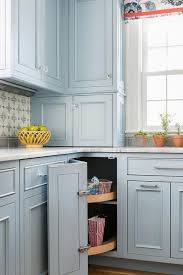 cornflower blue cabinets with glass knobs