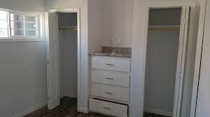 image of standard dual closet setup with dresser in the middle tv jack over dresser