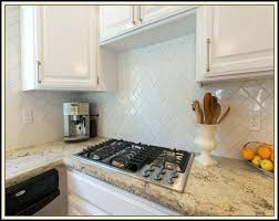 wood look tile backsplash beveled subway tile herringbone