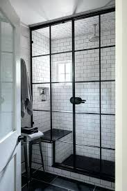 of steel framed doors and windows that form the shower enclosure in this bath give industrial
