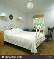 white wrought iron bed. Contemporary Wrought White Wrought Iron Bed With White Bedcover In Nineties Bedroom Sisal  Carpet And Pale Blue Wallpaper With Wrought Iron Bed