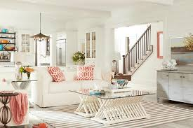 white beach furniture. white beach house living room with pink accents furniture