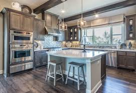 this kitchen features maple cabinets with a driftwood gray sn and taylorcraft cabinet doors this is a great alternative to gray paint