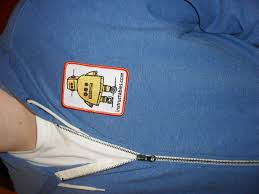 picture of how to easily sew a patch onto a shirt or jacket